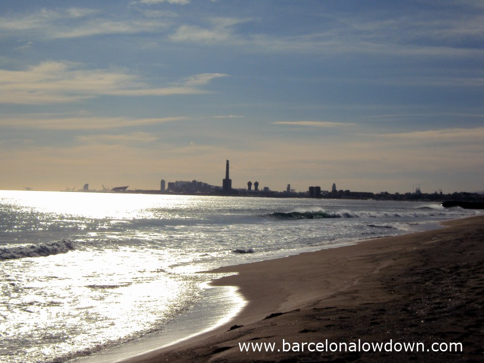 Winter sunshine on a deserted beach at Montgat with views to Barcelona.