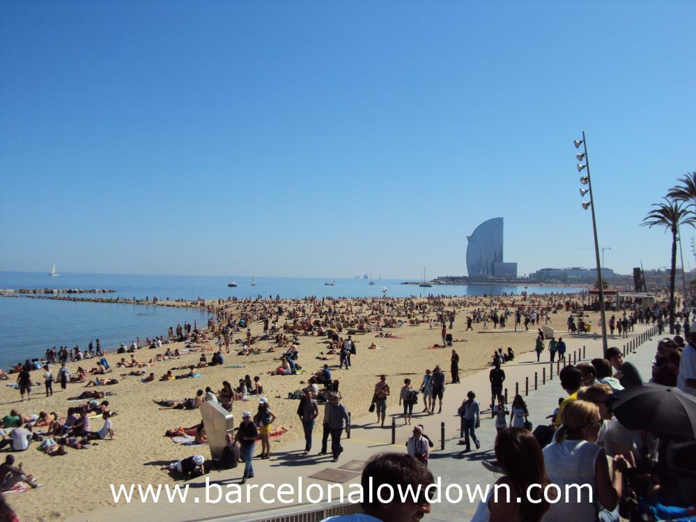 Locals and tourists enjoying the spring sunshine on the Barcelonata beach.