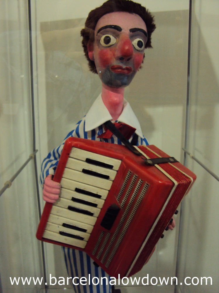 A puppet playing an acordian