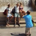 Tourists taking photos in front of a fountain near the MNAC Barcelona