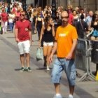 Photo of locals and tourists in Barcelona's Porta del Angel during August