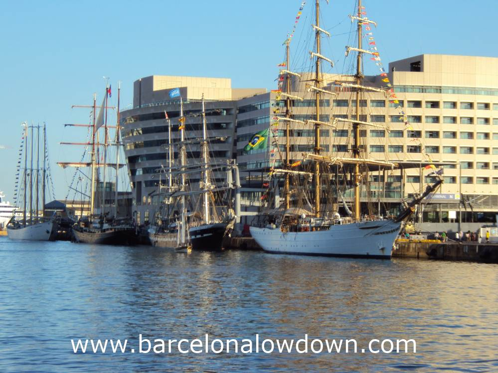 4 tall ships moored up in a row in Barcelonas old harbour (Port Vell)