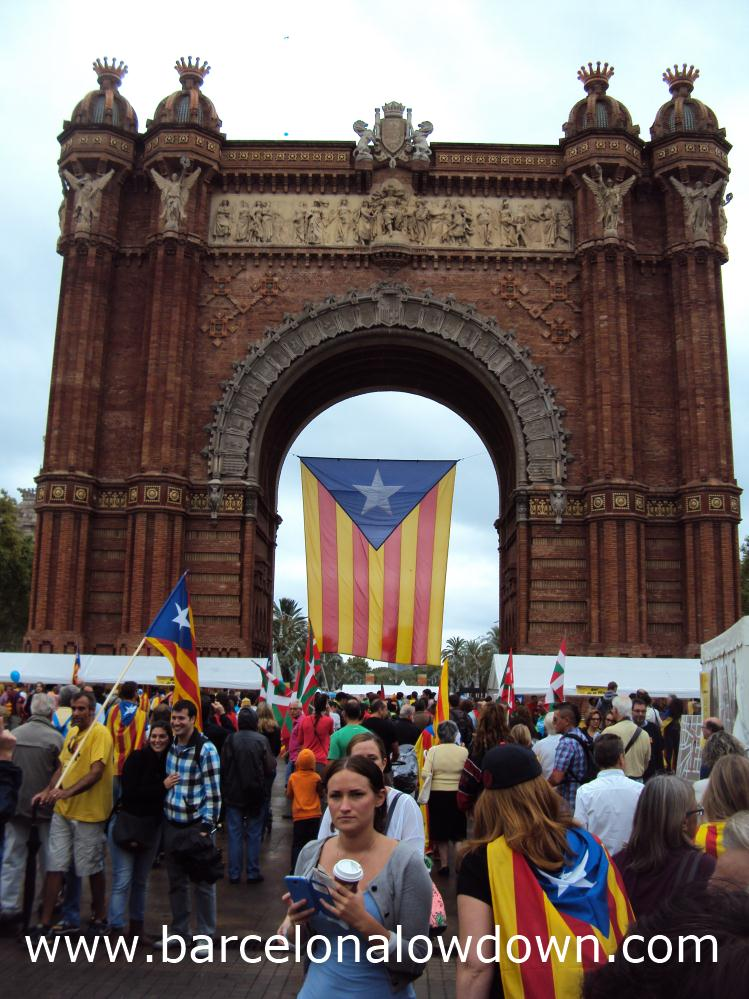 A giant Catalan independence flag flying at the Arc de Triomf Barcelona