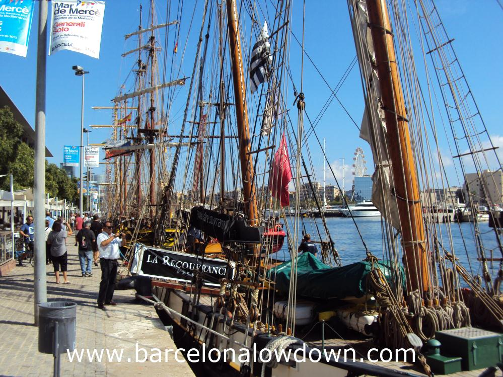 A row of tall ships moored up in Barcelona's Port Vell