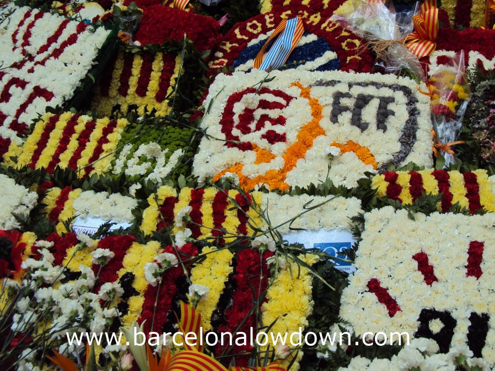 Floral tributes laid out in front of the Rafael Casanova monument during Catalonia's National Day 2013