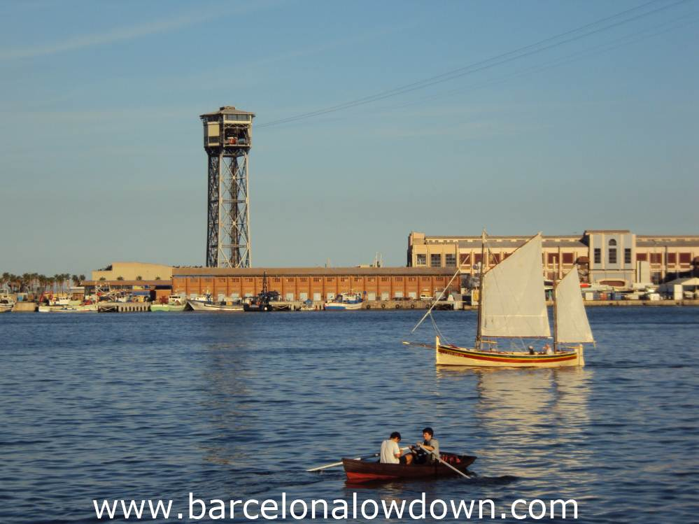 A sailing boat and a rowing boat in Barcelona's port