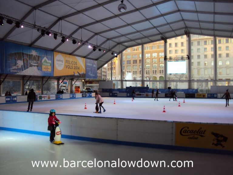 Adults and children skating at the BarGelona Christmas Ice Rink on Plaça de Catalunya in Central Barcelona