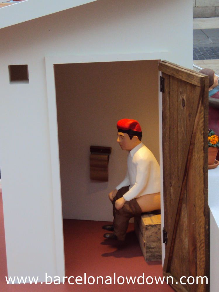 The Caganer sits on a rooftop toilet in the nativity scene in Plaça Sant Jaume