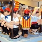 Traditional Catalan Caganer figures with estelada independence flags