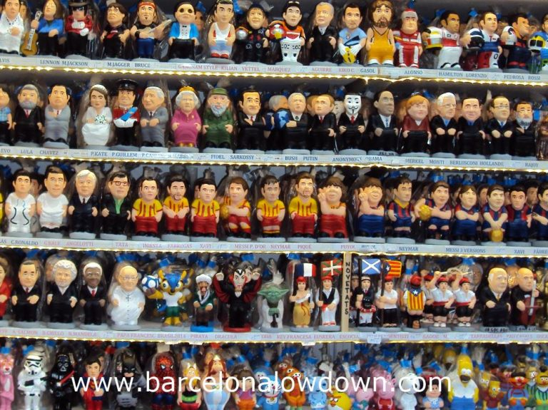 Lots of colourful Caganers for sale on a stall at one of the Christmas Markets in Barcelona