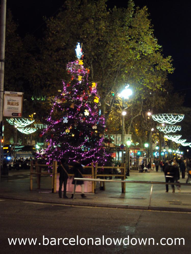 Christmas tree and lights on the shopping street Passeig de Gracia, Barcelona