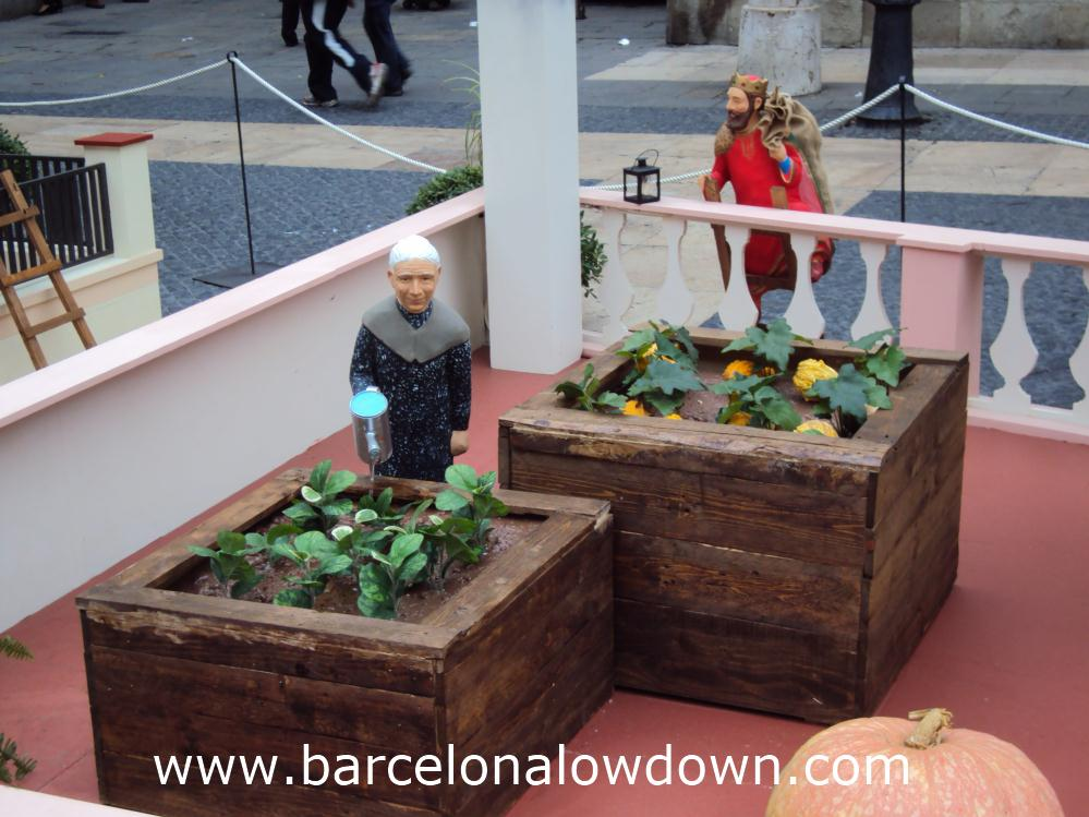 Granny tending her garden, part of the Pessebre near Barcelona city hall