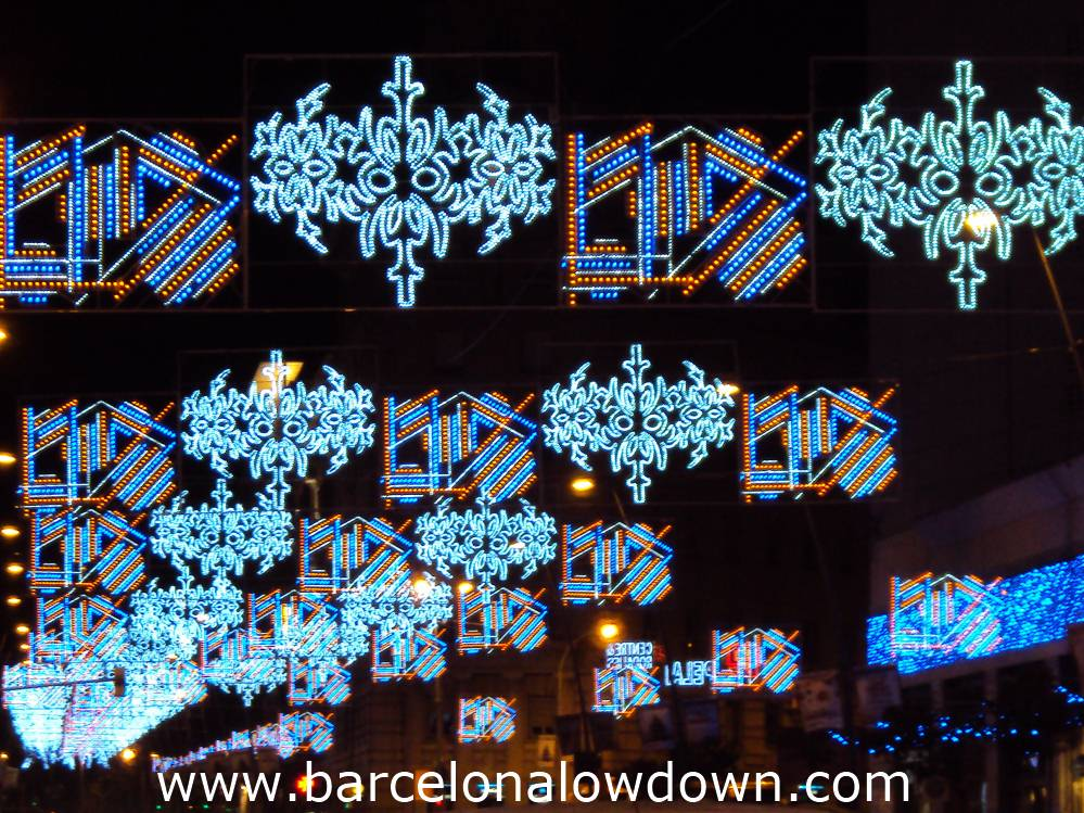 Christmas lights decorating Carrer Pelai in central Barcelona