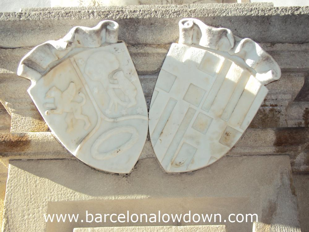 Barcelona and Madrid's coats-of-arms carved in marble