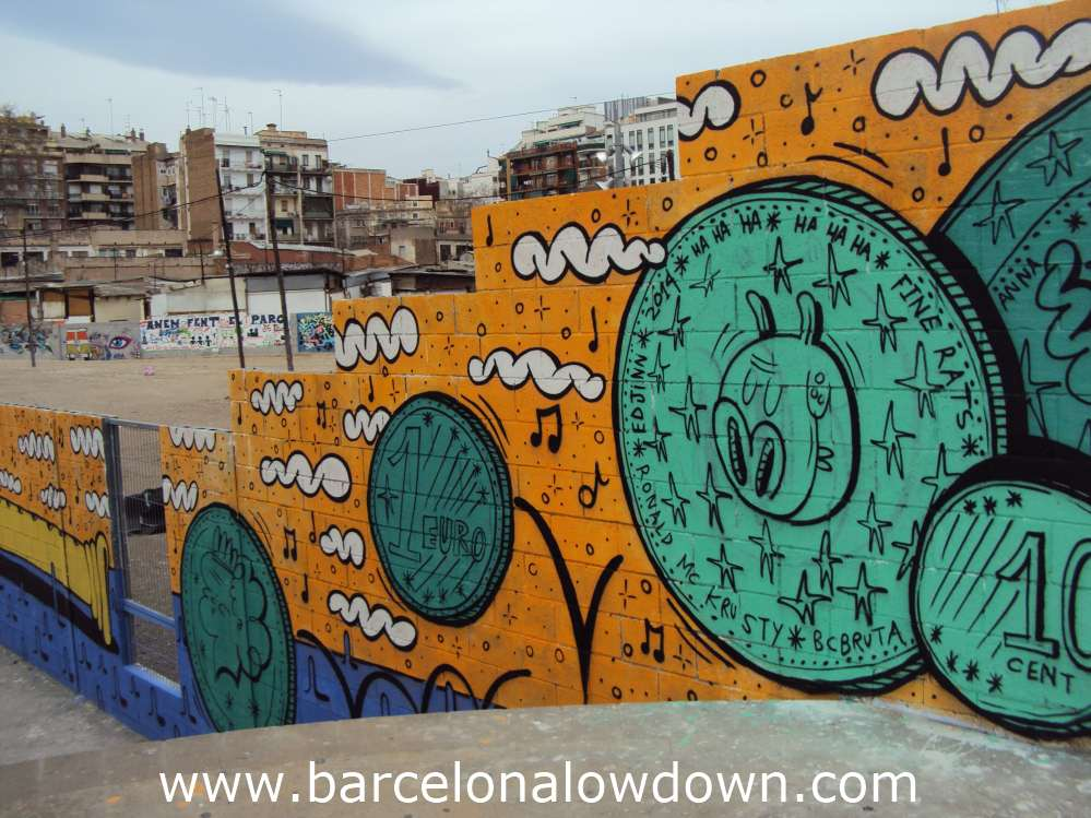 Street art, green coins bouncing down steps painted on a wall in Barcelona, in the background you can see buildings of the clot district of Barcelona.