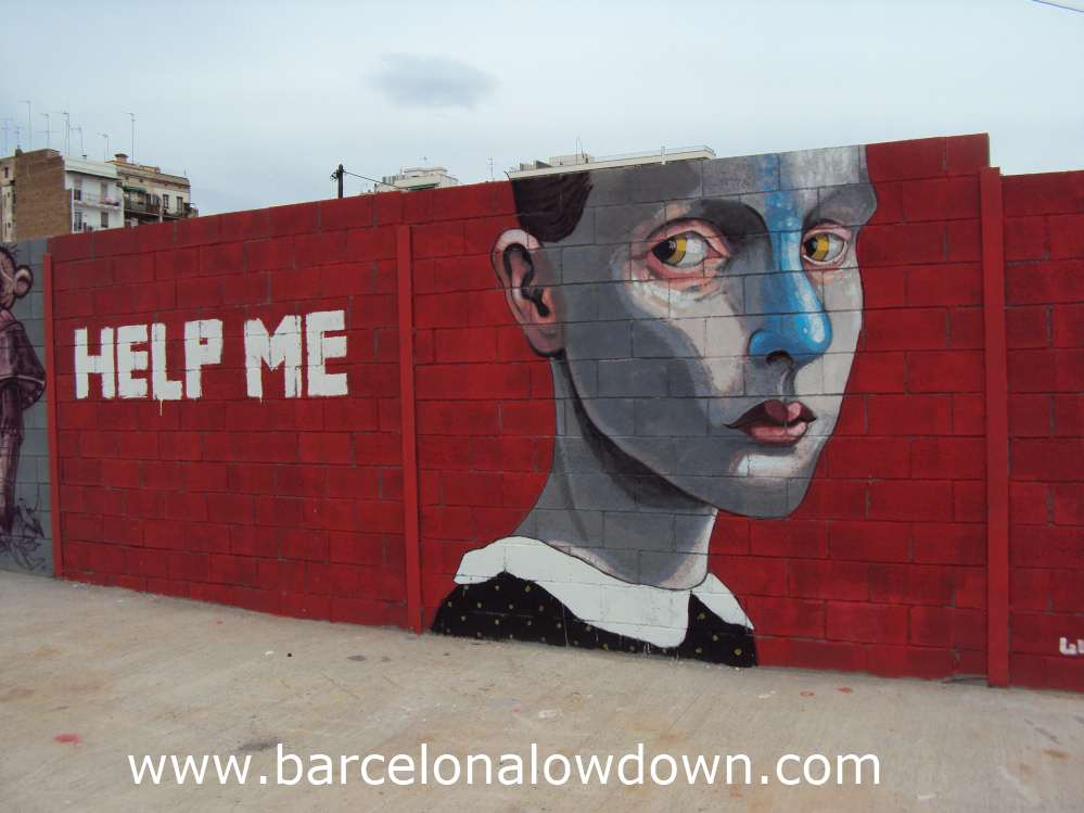 Urban art painted on a wall showing a serious looking girl on ared background with the words help me painted in white capitals.