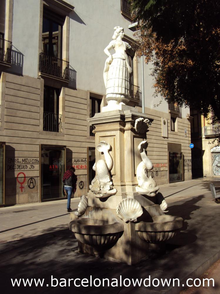 The 5m high white marble Maja fountain in Plaça Vila de Madrid, Barcelona