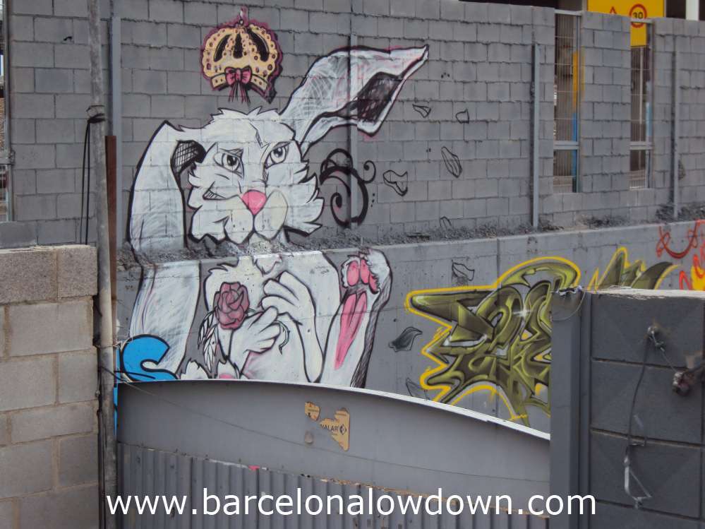 Crazy looking rabbit graffiti and various tags.