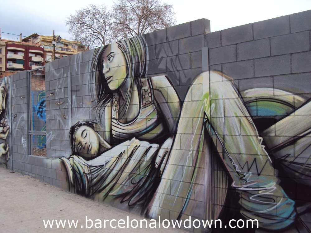 Painting of a young couple painted on a wall in Barcelona, part of the firsta us barcelona street art event