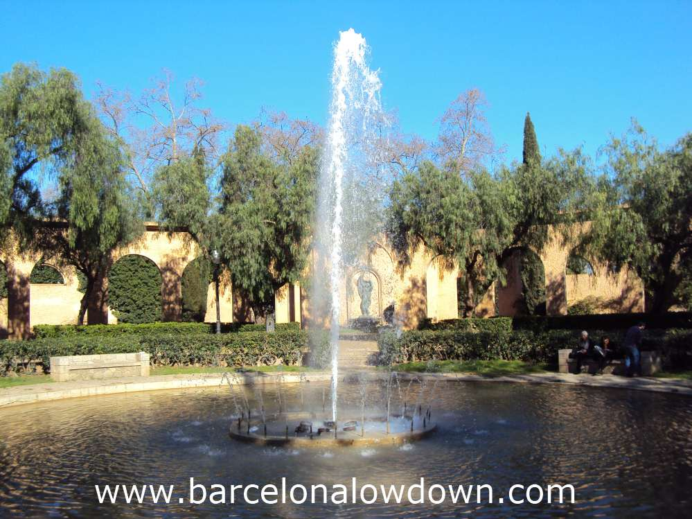 A decorative fountain surrounded by trees in one of the parks on Montjuic hill Barcelona
