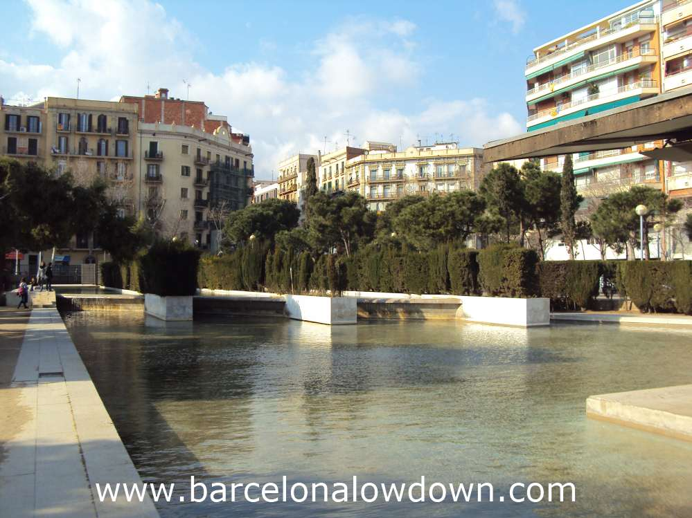 The shallow artificial lake surrounding the public library in Miró Park Barcelona