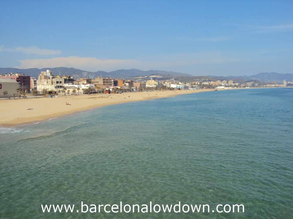 Photo of Badalona taken from the Pont del petroli jetty on a sunny day