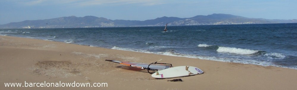 Windsurfer on the long sandy beach at Sant Pere Pescador, Spain