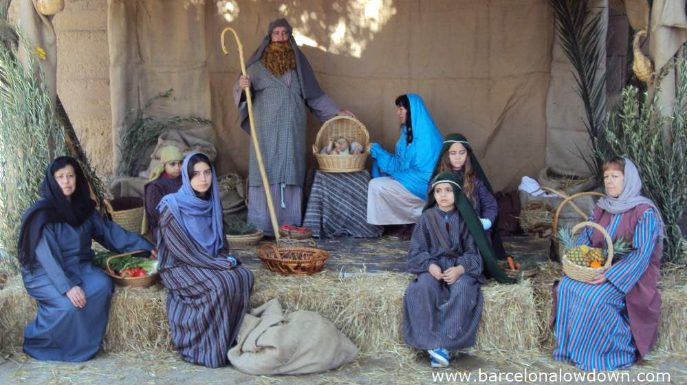 Bored looking actors in a living nativity scene in Poble Espanyol, Barcelona