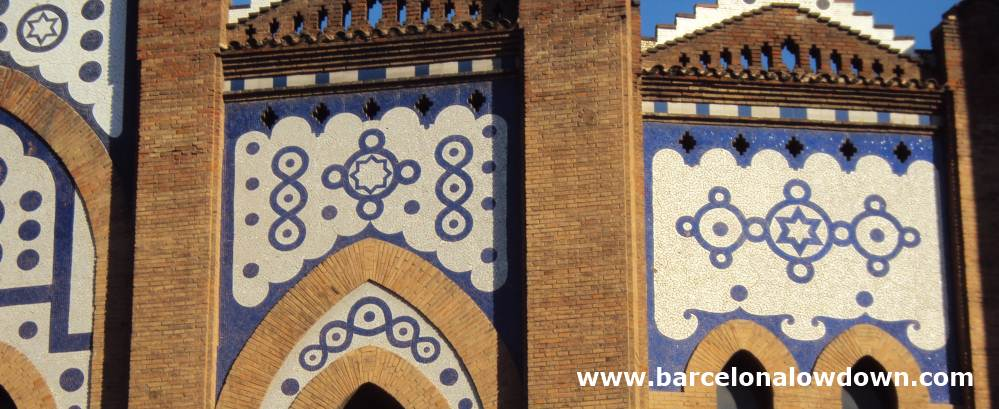 Blue and white tiles which form geometric designs on the outside walls of the plaça de toros monumental bullring in Barcelona