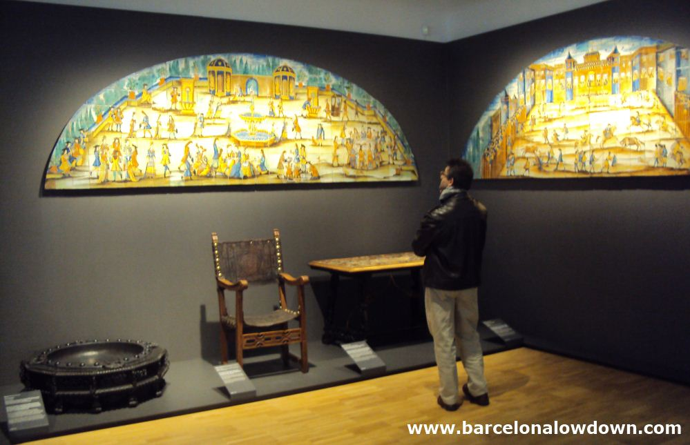 A visitor to the Barcelona Design museum looking at a set of hand painted tiles