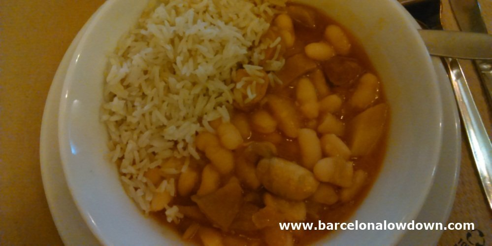 A warming bowl of vegetarian Asturian style fabada bean casserole served in Amaltea, BCN. Traditionally this dish contains meat but here the meat is replaced with tofu makig it 100% vef¡getarian.