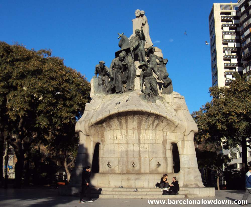 Monument to Dr Robert surrounded by trees in Plaça de Tetuan Barcelona