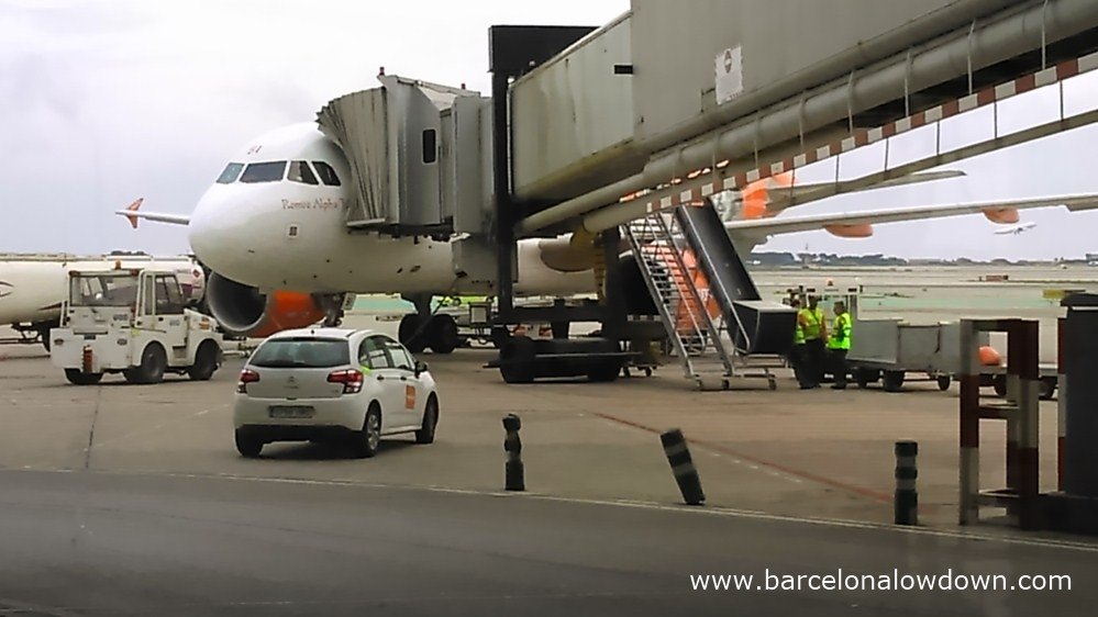 An easyjet plane connected to an air bridge at Barcelona terminal T2 section C