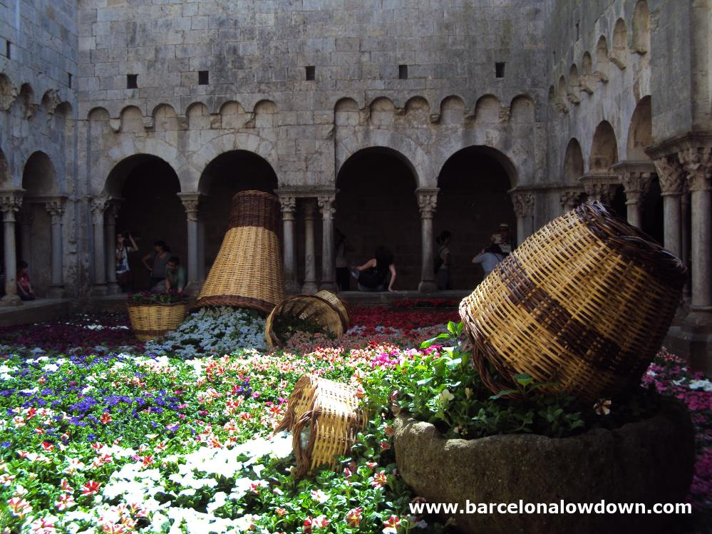 A colourful floral display in the pretty medieval cloisters of Girona Cathedral