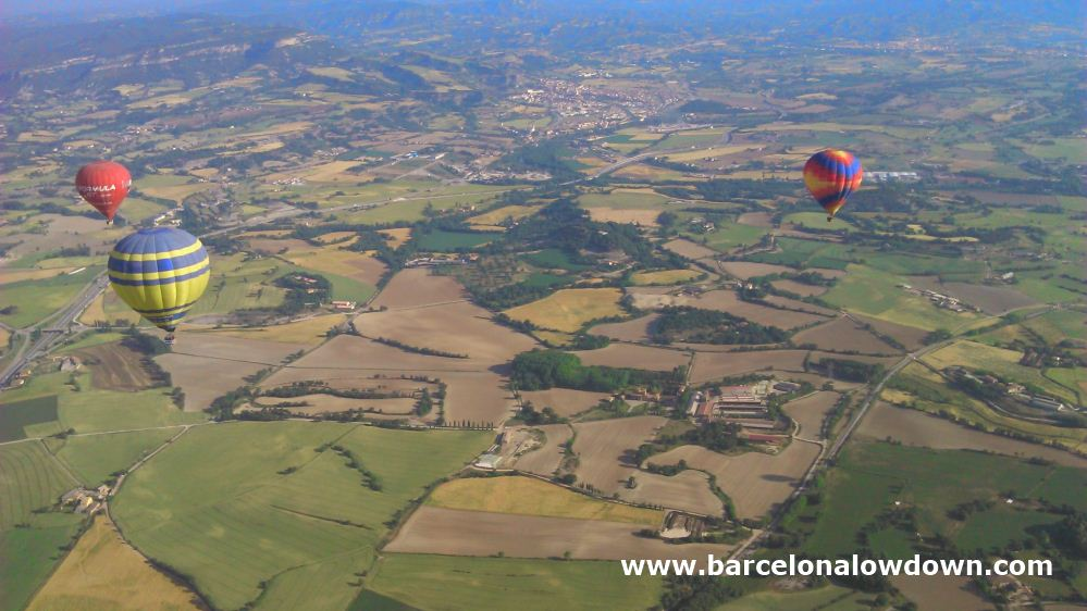 3 hot air balloons and a patchwork of fields near the Catalan Costa Brava