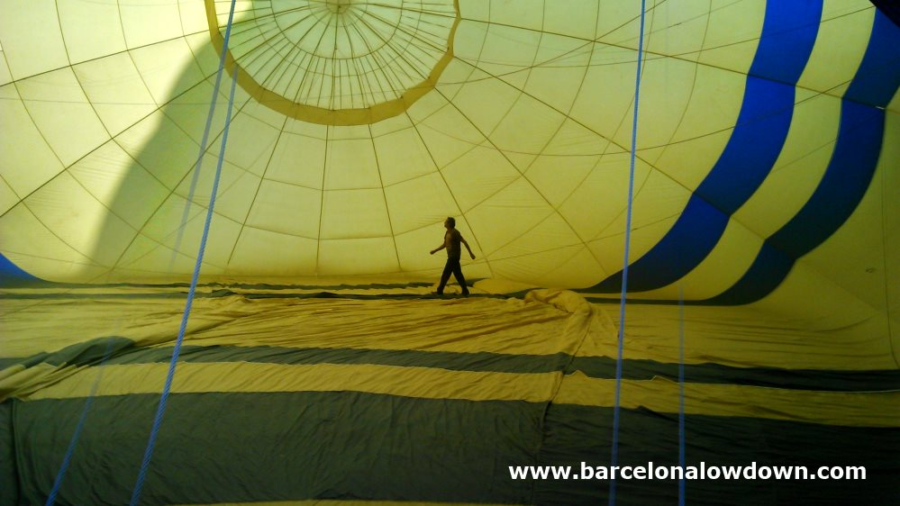 The pilot of our balloon carefully checking that everything was OK shortly before take off near Barcelona