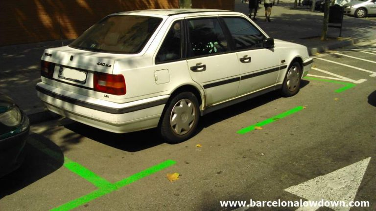 A Car parked in the green zone which becomes free parking in Barcelona during August