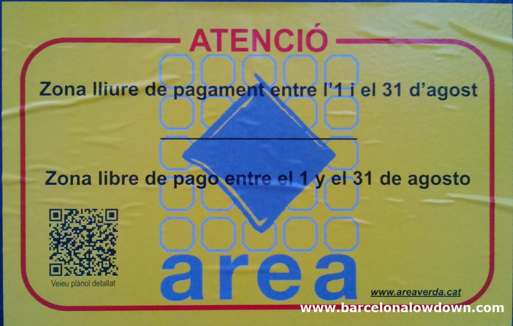 The yellow sign which is pasted on parking meters in the free parking areas of Barcelona during August