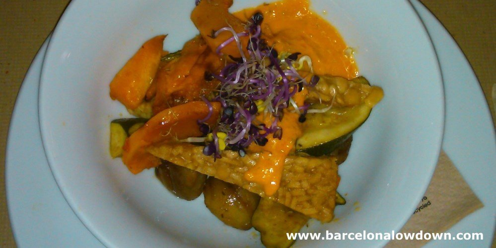 A delicious plate of tempeh with chestnuts and vegetables in one of the best vegetarian restaurants in Barcelona Spain