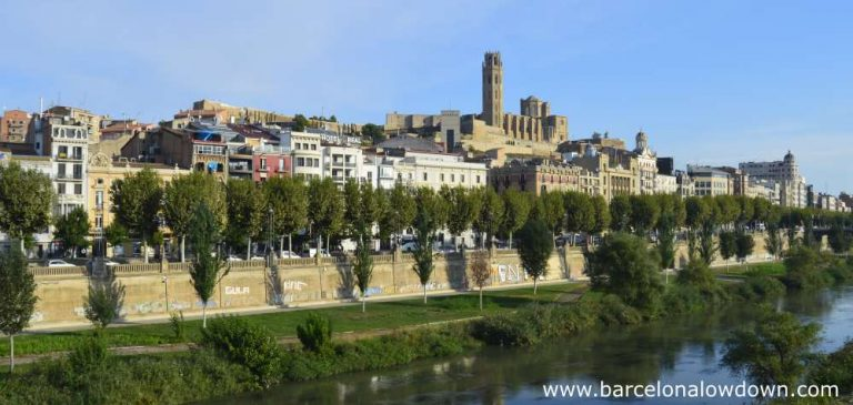 Photo of the Catalan city of Lleida taken from one of the bridges which span the River Segre. The city is dominated by the impressive medieval Seu Vella cathedral and castle which dominate the city.