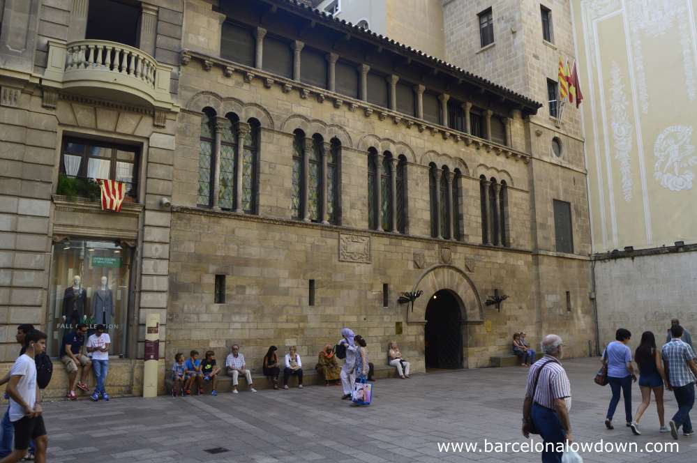 Plaça de la Paeria in Lleida with the beautiful medieval Romaneque style town hall