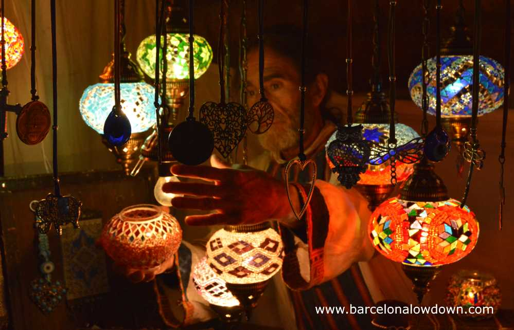Turkish coloured glass lamps for sale at the medieval market of Vic