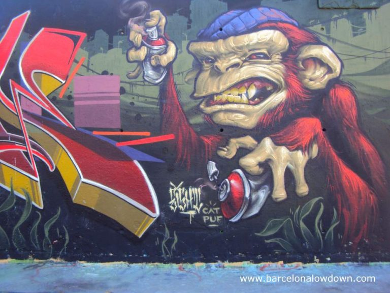 Monkey graffiti artist painted on one of Barcelona's first legal graffiti walls in the Parc de les 3 xemeneies