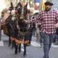 Man in traditional Basque costume leading a horse drawn kart in the tres tombs parade Barcelona