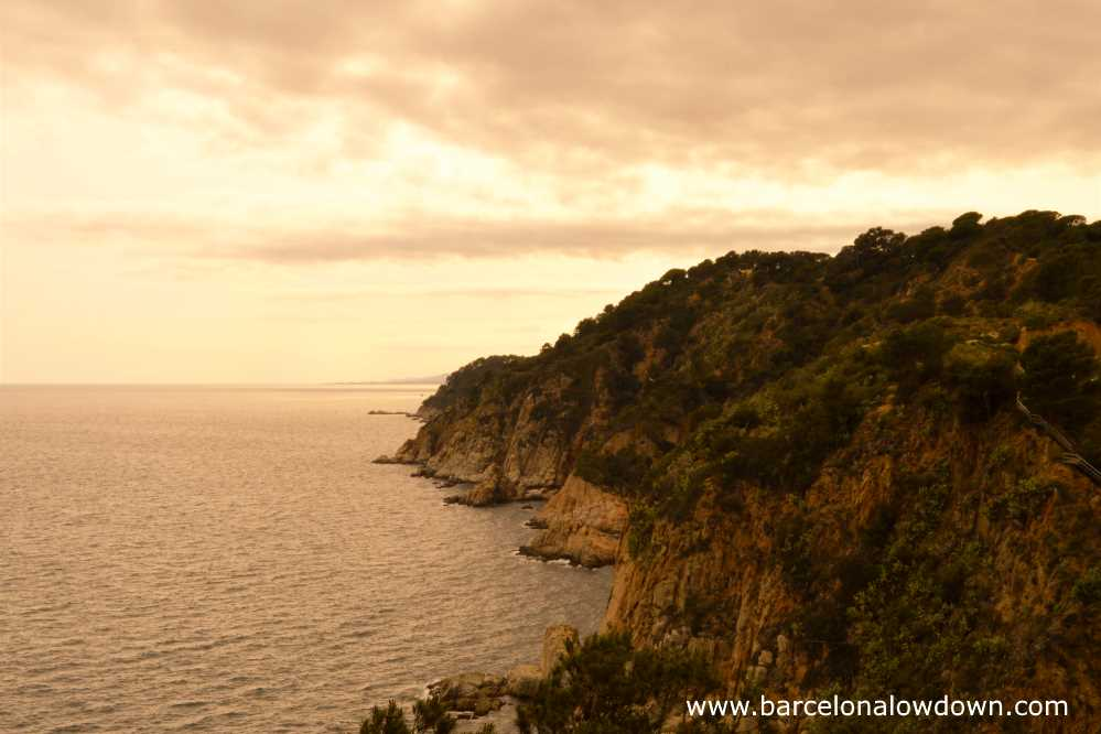 View of the Costa Brava from Tossa lighthouse on a cloudy afternoon. Catalonia.