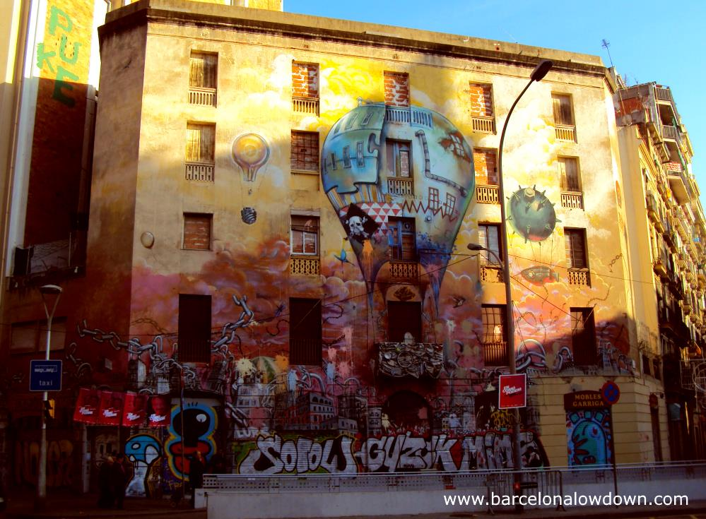 The main facade of the graffiti covered La Carboneria in Barcelona's Sant Antoni neighbourhood