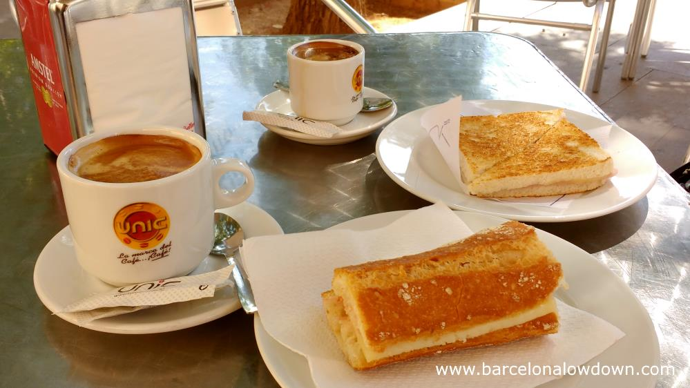 A late breakfast consisting of bread, cheese and coffee is best enjoted in a sunny plaza in Barcelona