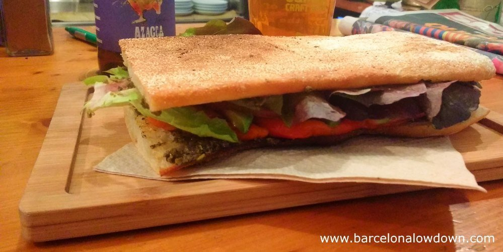 A so called escalivado vegan sandwich served on coca bread at the Quinoa bar in Barcelona's trendy Gracia neighbourhood