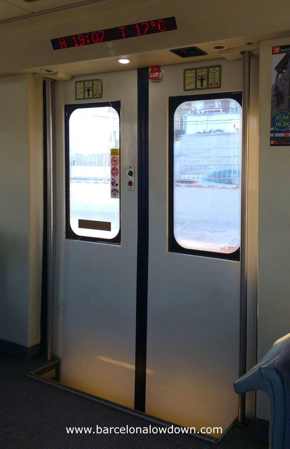 LED display above the doors of an older type Spanish commuter train
