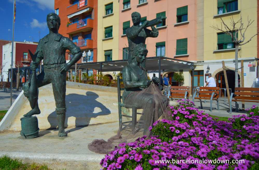 Bronze statue depicting a group of fisherman in the Serrallo fishing neighbourhood next to the Port of Tarragona, Spain
